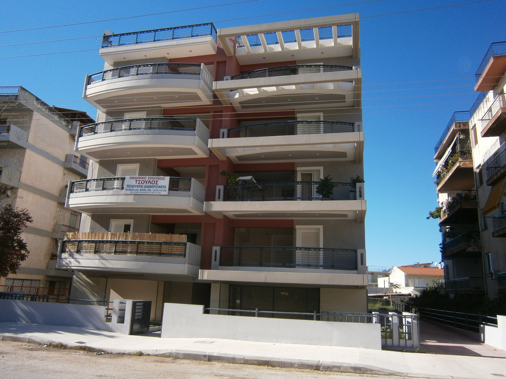 Patras new 4 storey apartment building with ground floor garages and basement storage rooms